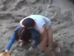 Gorgeous couples love some interesting beach sex